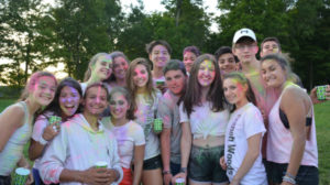 Group photo of campers covered in colorful chalk