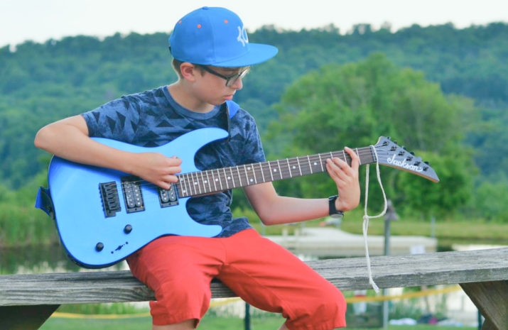 Camper playing the electric guitar