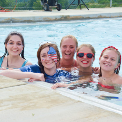 Group of campers smiling in the pool