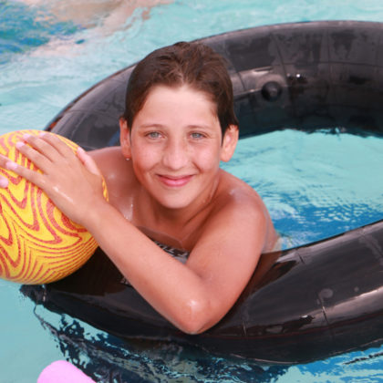 Camper smiling in the pool
