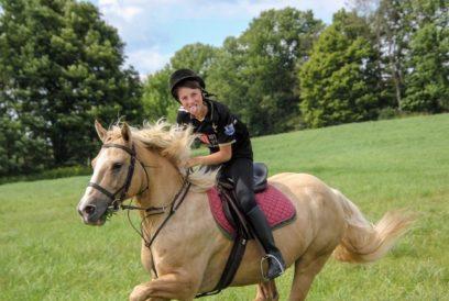 boy riding horse having fun