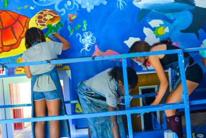 Campers painting a mural