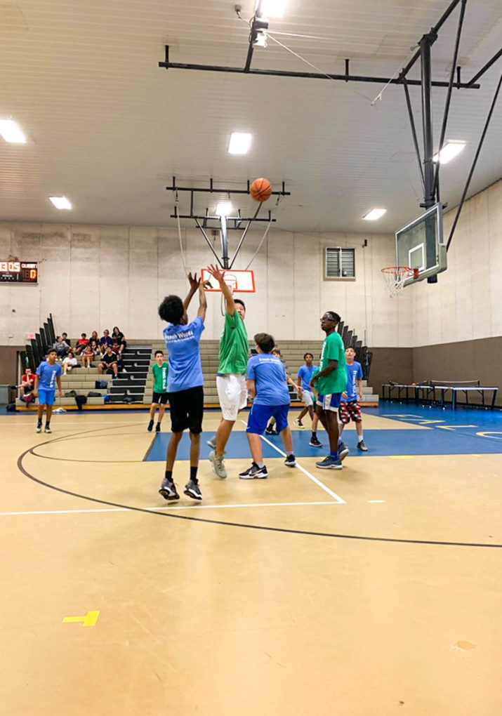 Campers playing a basketball game