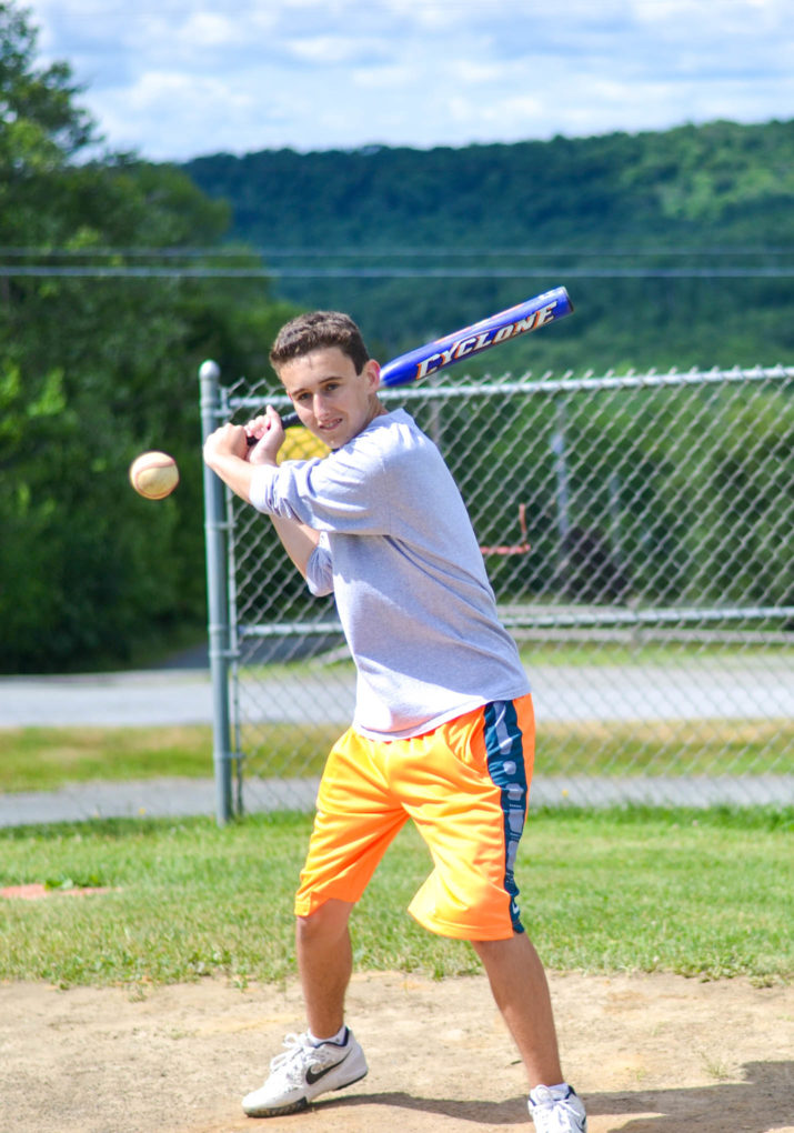 Camper getting ready to hit a ball with a baseball bat