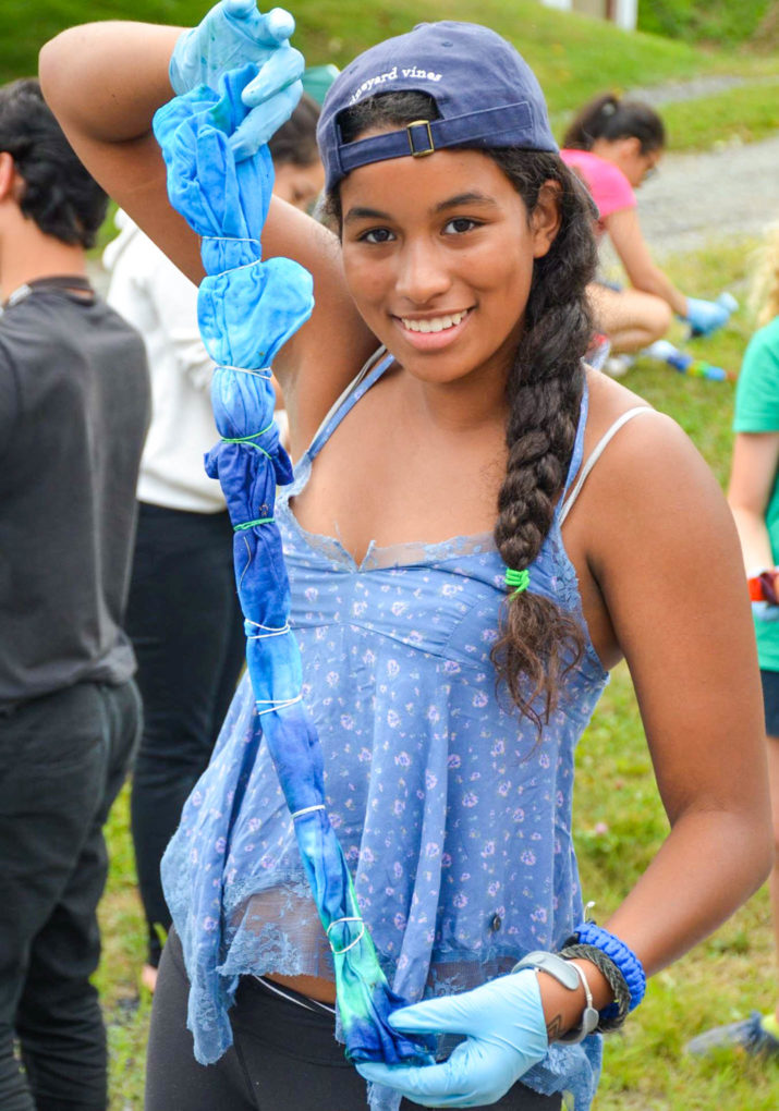Camper holding up a shirt she is tie dying