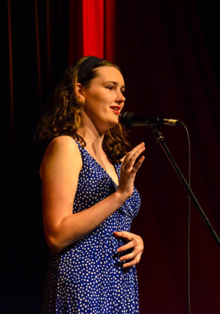 Girl camper singing on stage