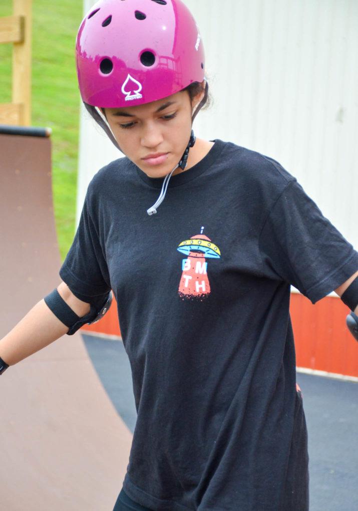 Girl camper skateboarding