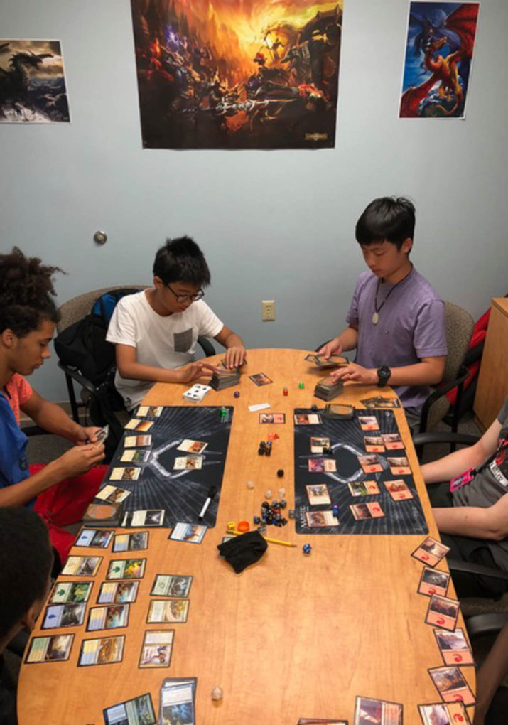 Group of boys playing a table top role playing game