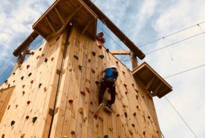Camper climbing the rock wall