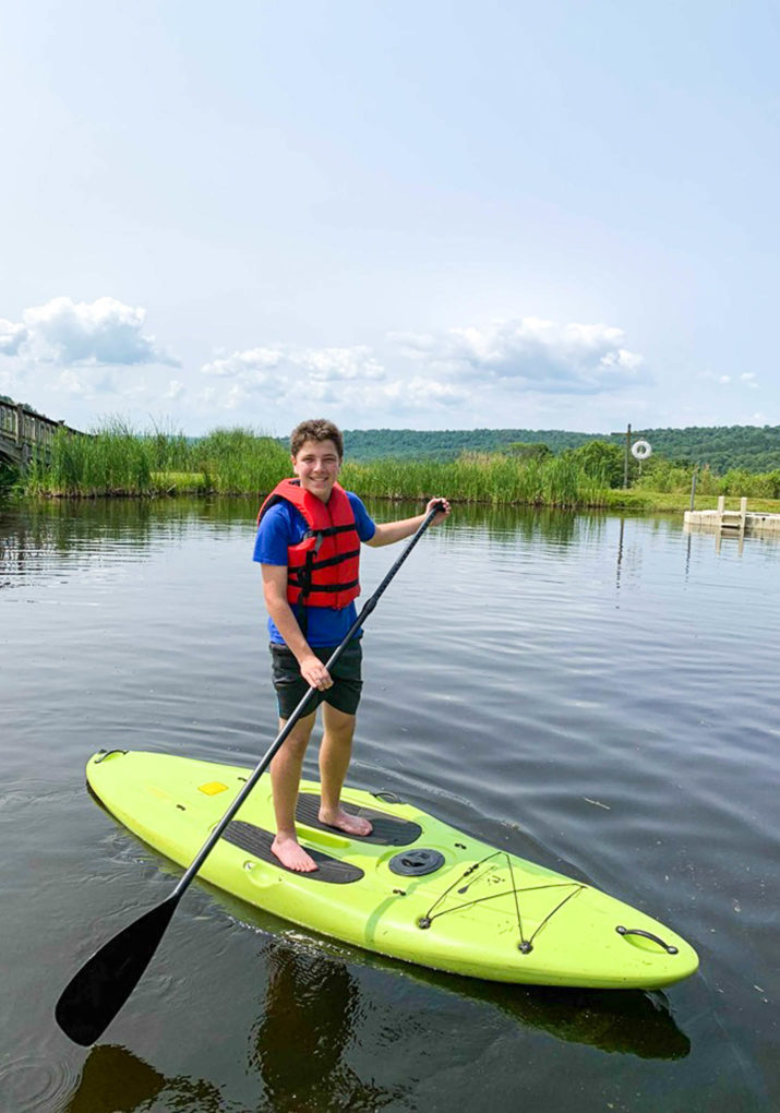 Camper on a stand up paddle board