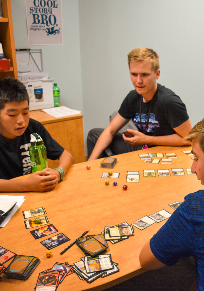 Campers playing a tabletop rpg