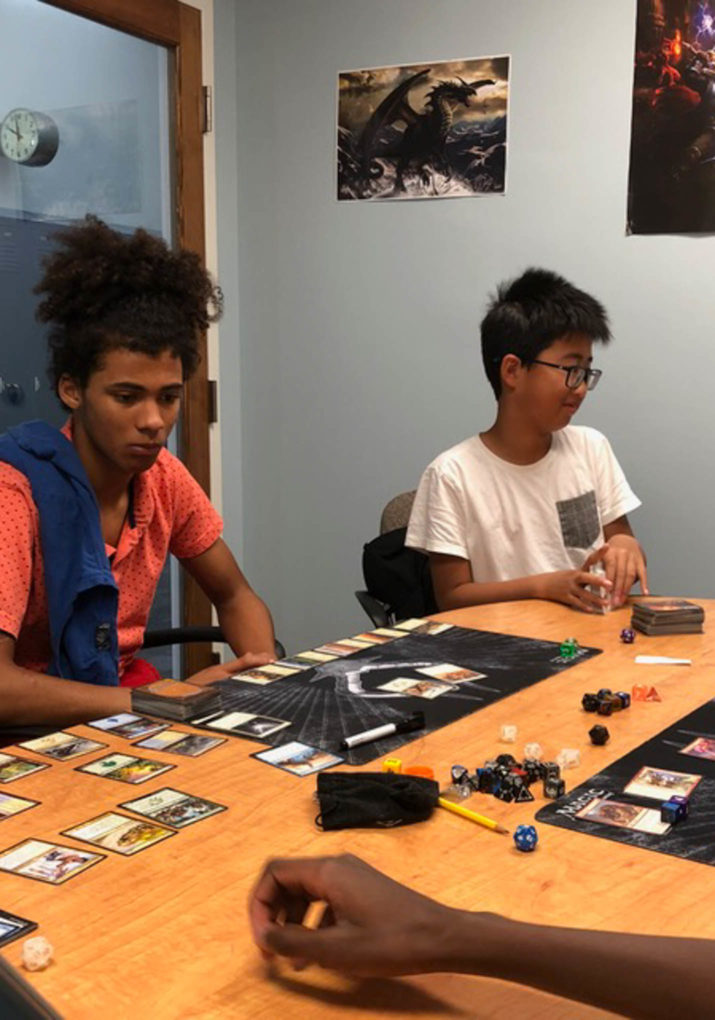 Two boys playing a table top role playing game