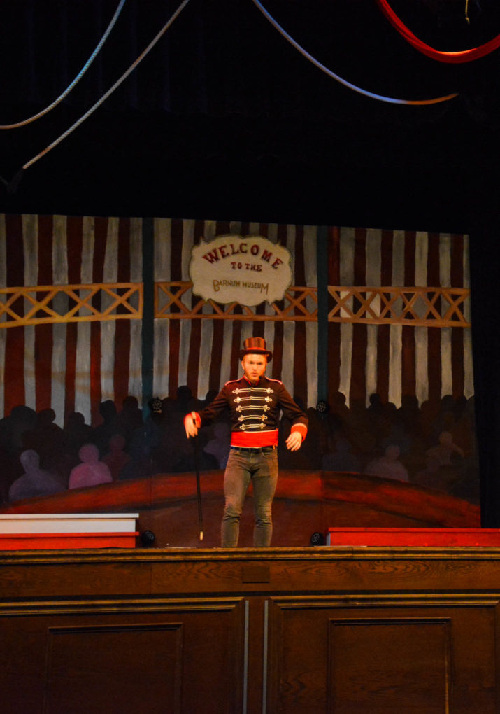 Male camper performing a scene on stage