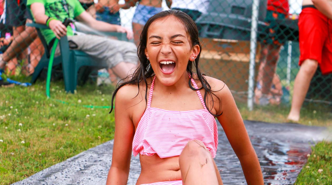 Girl having fun on the slip-n-slide