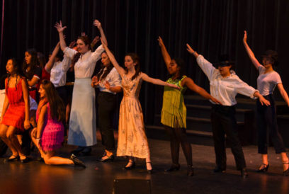 Campers performing a scene on stage