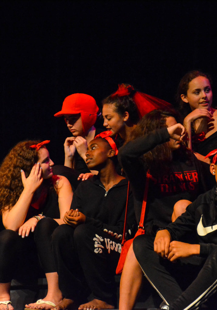 Group of campers on stage performing