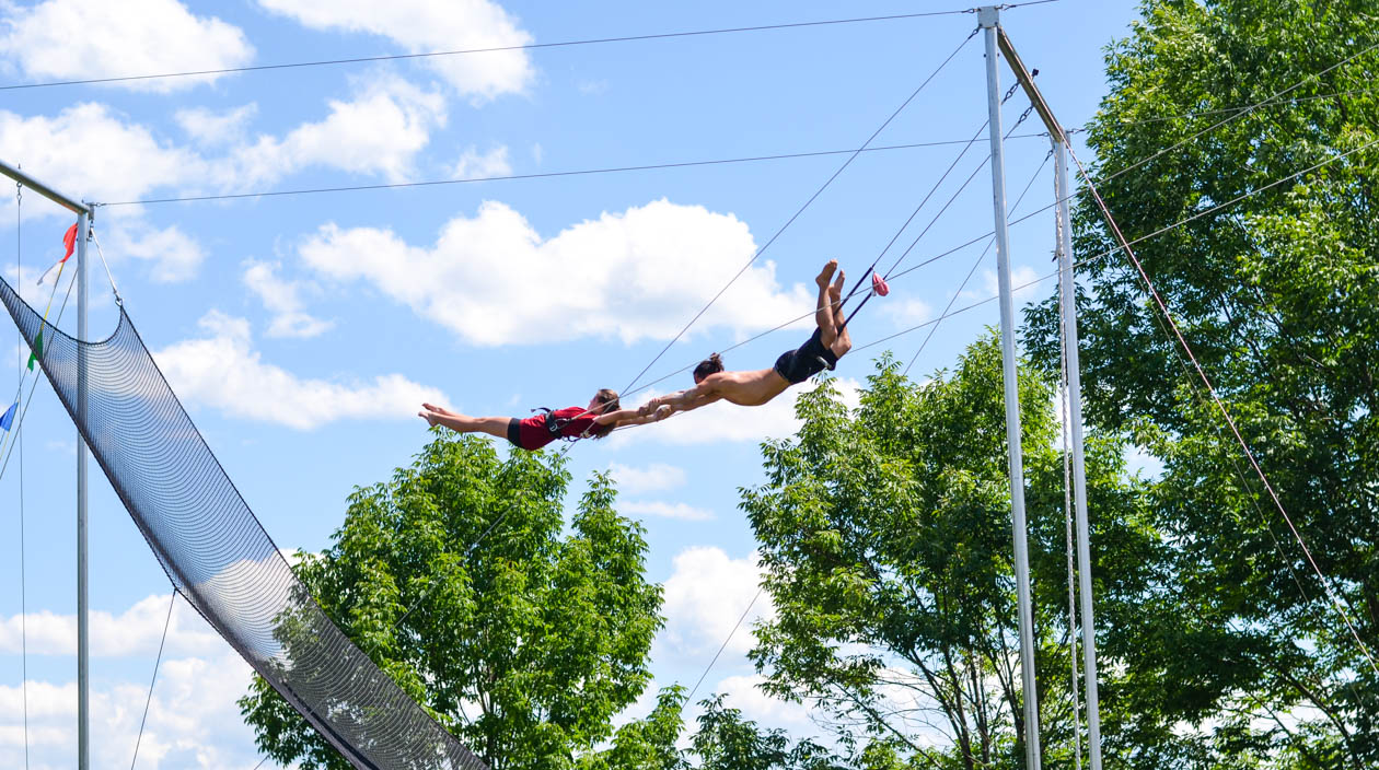 Campers flying on the trapeze rig