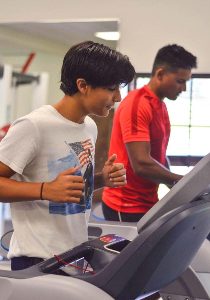 Boys running on treadmills