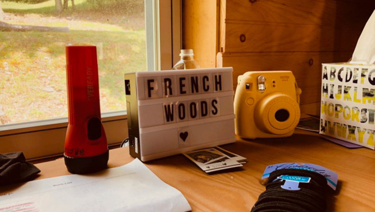 Small marquee sign with French Woods on it