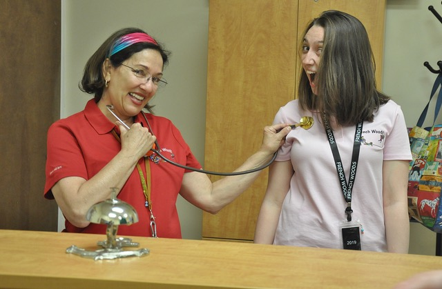 School nurse and student smiling.